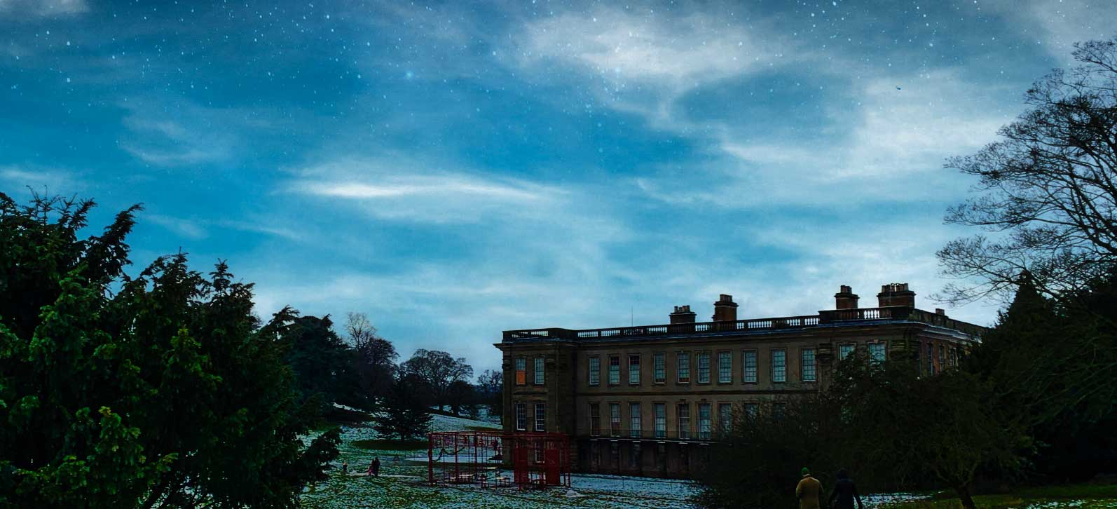 Calke Abbey with snow and starry sky