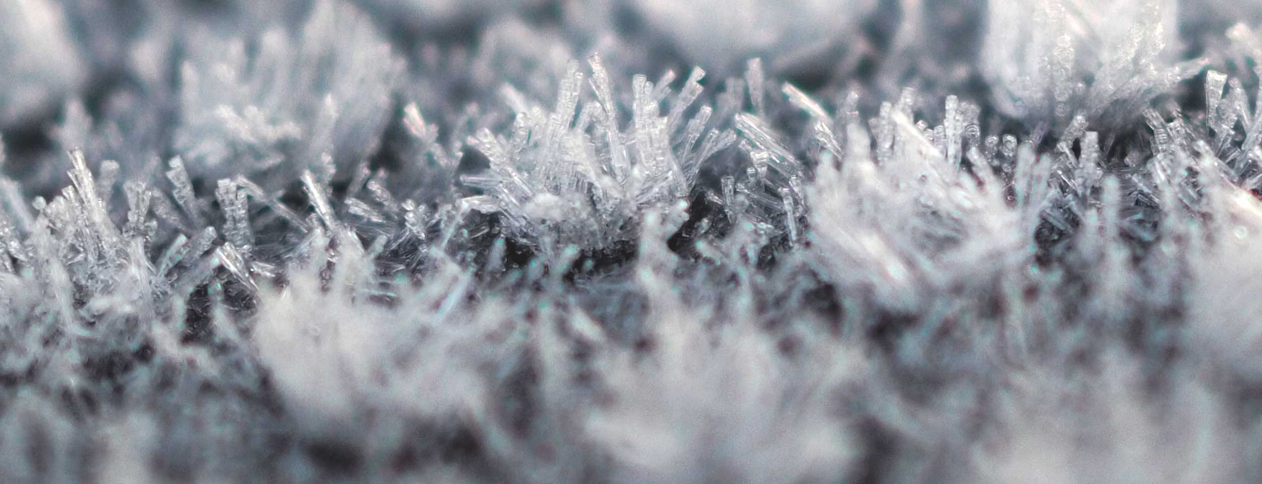 Macro view of frost crystals on play equipment
